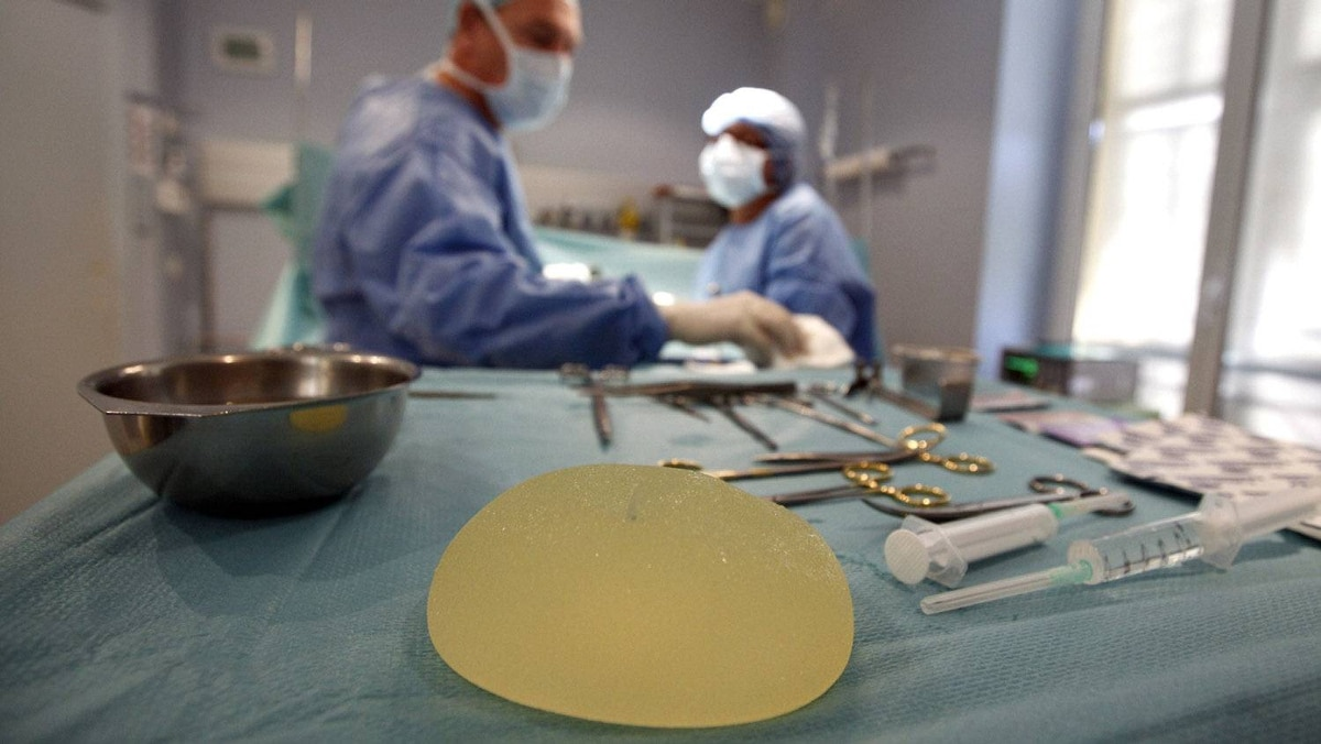 A defective silicone gel breast implant manufactured by French company Poly Implant Prothese (PIP) is seen near surgical instruments after being removed from a patient by plastic surgeon Denis Boucq (L) in a clinic in Nice December 21, 2011. French medical device regulatory authority (AFSSAPS) recalled PIP breast implants in March 2010 after it concluded that their performance and safety were not in accordance with current standards.