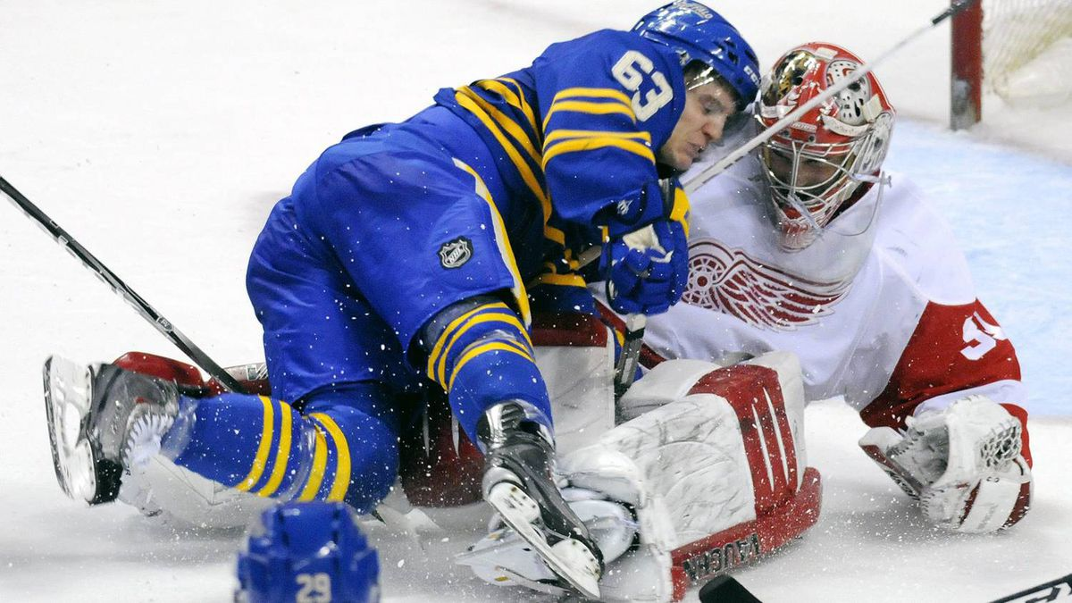 Detroit Red Wings goalie Joey MacDonald, right, stops Buffalo Sabres winger Tyler Ennis on a scoring chance during overtime of an NHL hockey game in Buffalo, N.Y., on Saturday, Feb. 26, 2011. Detroit won in a shootout 3-2. (AP Photo/Don Heupel)