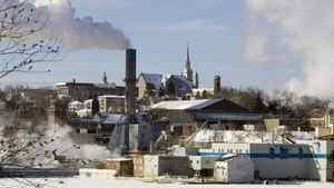 Smoke rises from the Abitibi-Consolidated mill in Shawinigan, Que. on Jan. 29, 2007. With global climate-change talks in limbo, Quebec says it's going ahead with a cap-and-trade program.