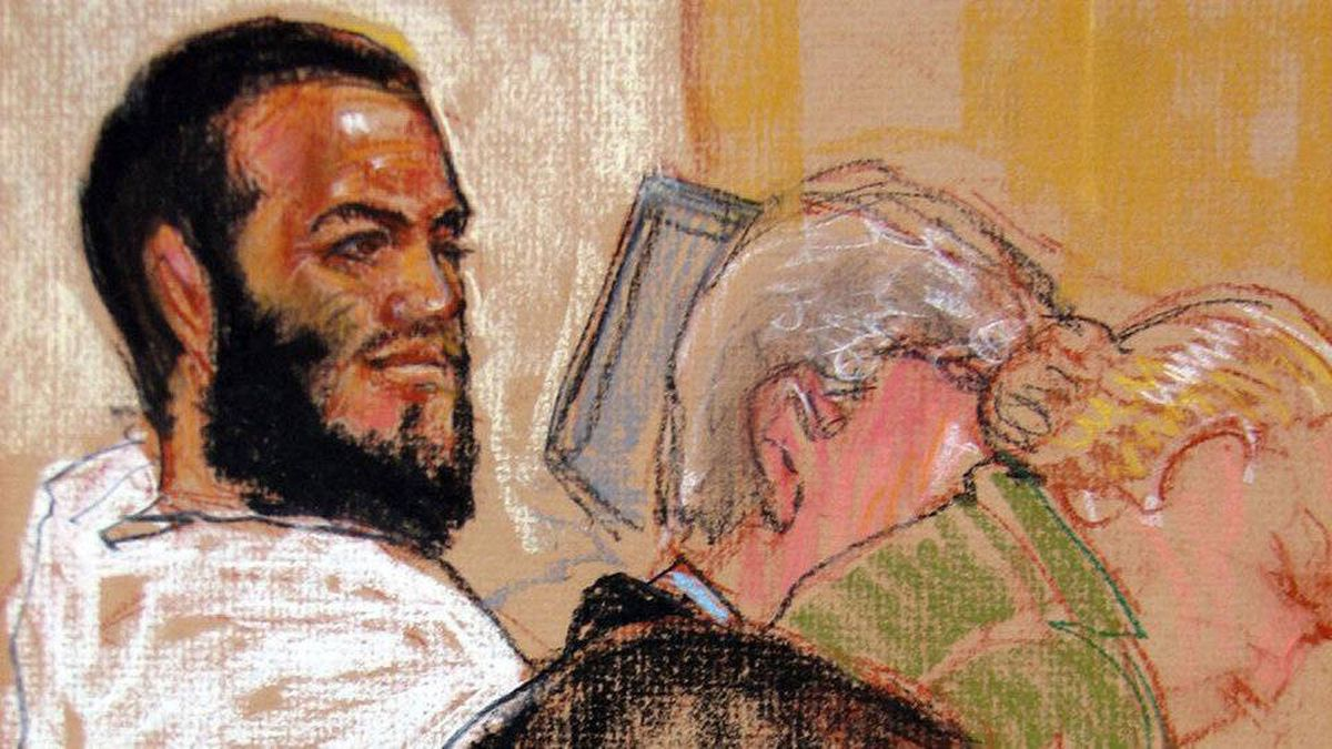Canadian defendant Omar Khadr attends his hearing in the courthouse for the U.S. military war crimes commission at Guantanamo Bay U.S. Naval Base in Cuba on Aug. 9, 2010.