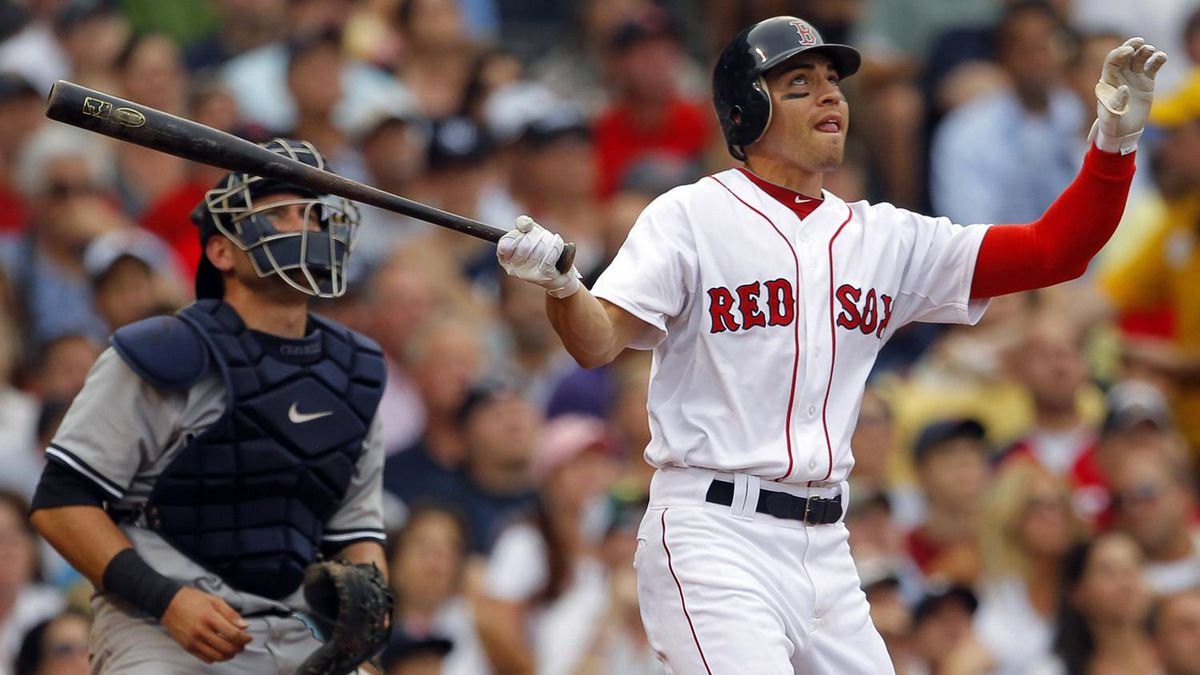 New York Yankees catcher Francisco Cervelli (L) and Boston Red Sox Jacoby Ellsbury watch Ellsbury's three-run home run in the fourth inning of their MLB American League baseball game at Fenway Park in Boston, Massachusetts August 6, 2011.