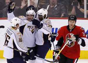 Nashville Predators' J.P. Dumont, second left, celebrates his goal against Ottawa Senators' goaltender Pascal Leclaire with teammates Cal O'Reilly, left, and Patric Hornqvist during the first period of their NHL hockey game in Ottawa, October 22, 2009.