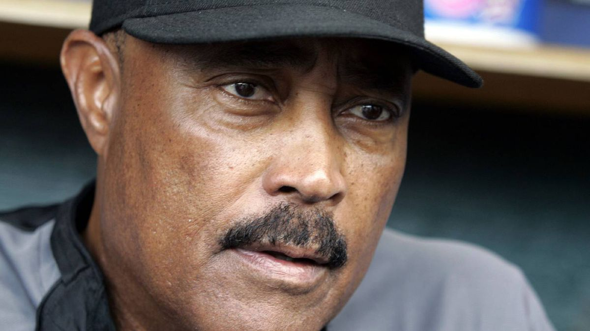 Toronto Blue Jays manager Cito Gaston talks with sports reporters in the dugout before the start of their MLB American League baseball game against the Detroit Tigers in Detroit, Michigan, September 14, 2009.