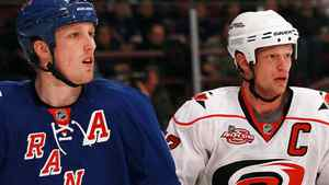 Marc Staal #18 of the New York Rangers skates against his brother Eric Staal #12 of the Carolina Hurricanes at Madison Square Garden on January 5, 2011 in New York City. (Photo by Bruce Bennett/Getty Images)