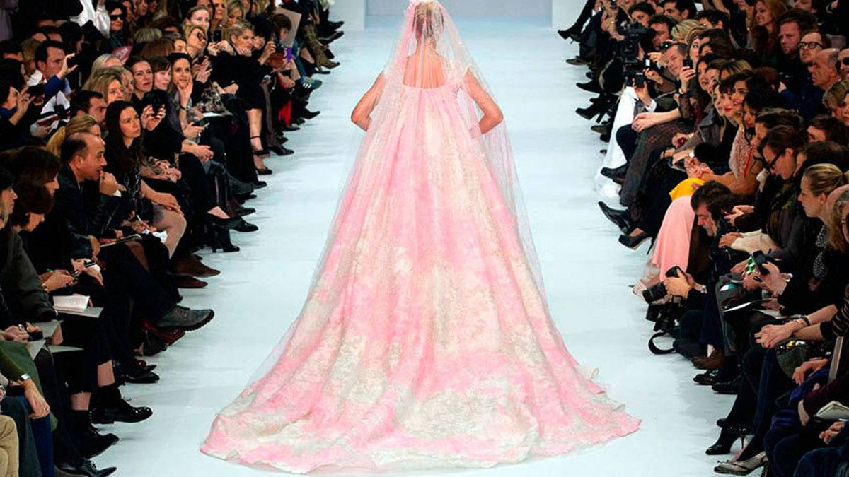 BILLOWING BACKS Though certainly sexy, exposed backs can be rather obvious. Far more romantic are those veiled in billowy, blousy fabrics. Giambattista Valli showed accordion pleating, while Elie Saab created wave-like layers.