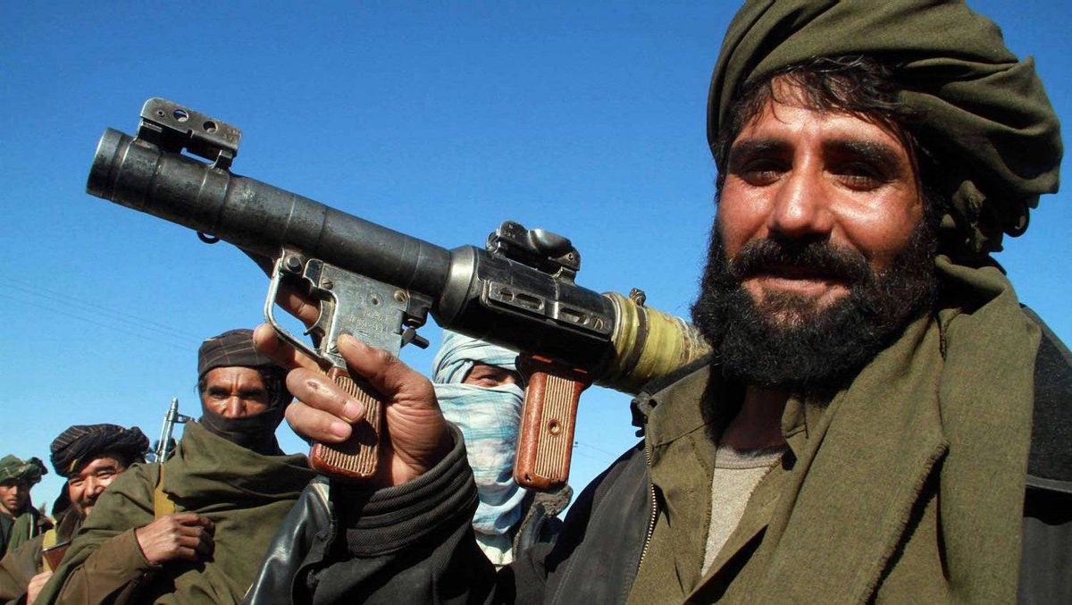 A Taliban militant poses for a picture after joining the Afghan government's reconciliation and reintegration program, in Herat on Jan. 30, 2012.