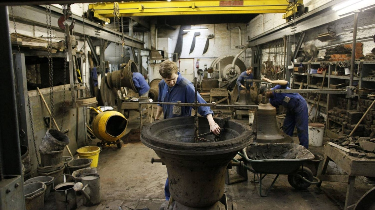 Employees make moulds of bells work at the Whitechapel Bell Foundry.
