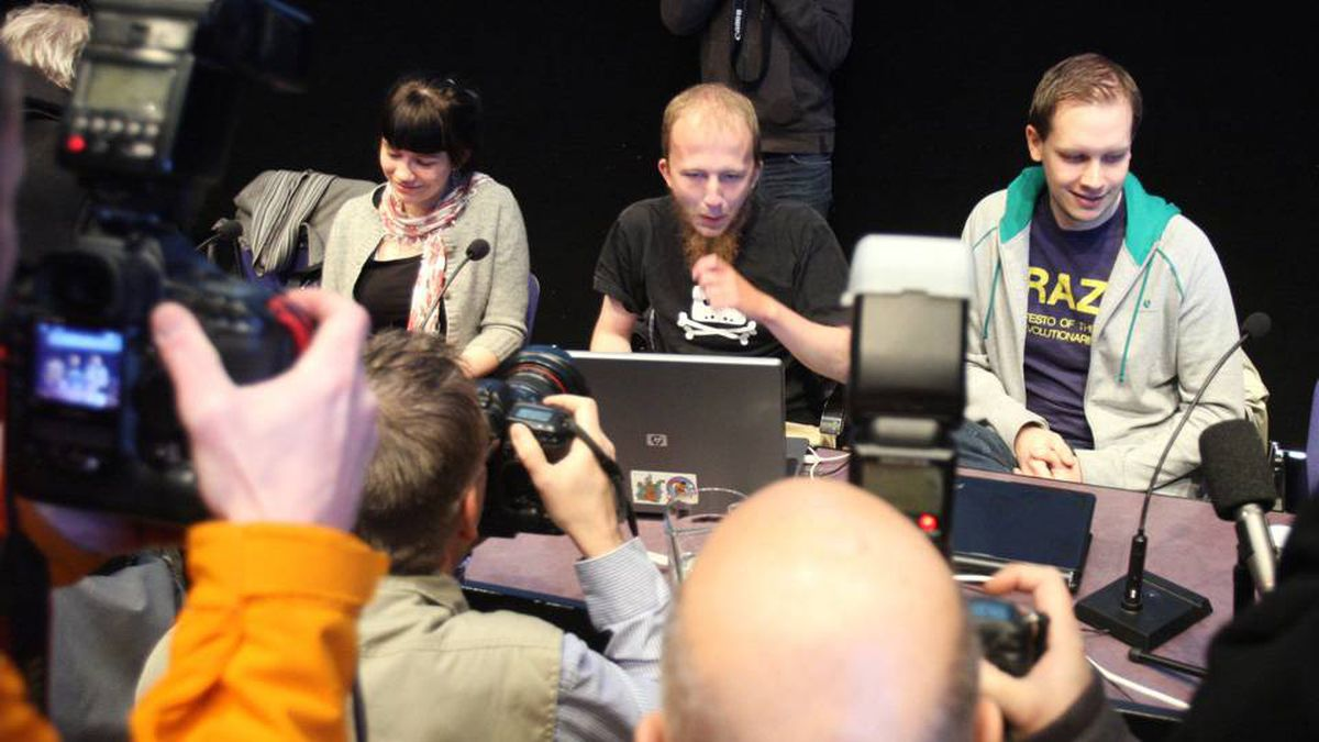 Files picture of Gottfrid Svartholm Varg (C) and Peter Sundin, (R) from The Pirate Bay, an online piracy site meeting the press in Stockholm, Sweden on February 15, 2009, to give their views prior on the eve of their trial.