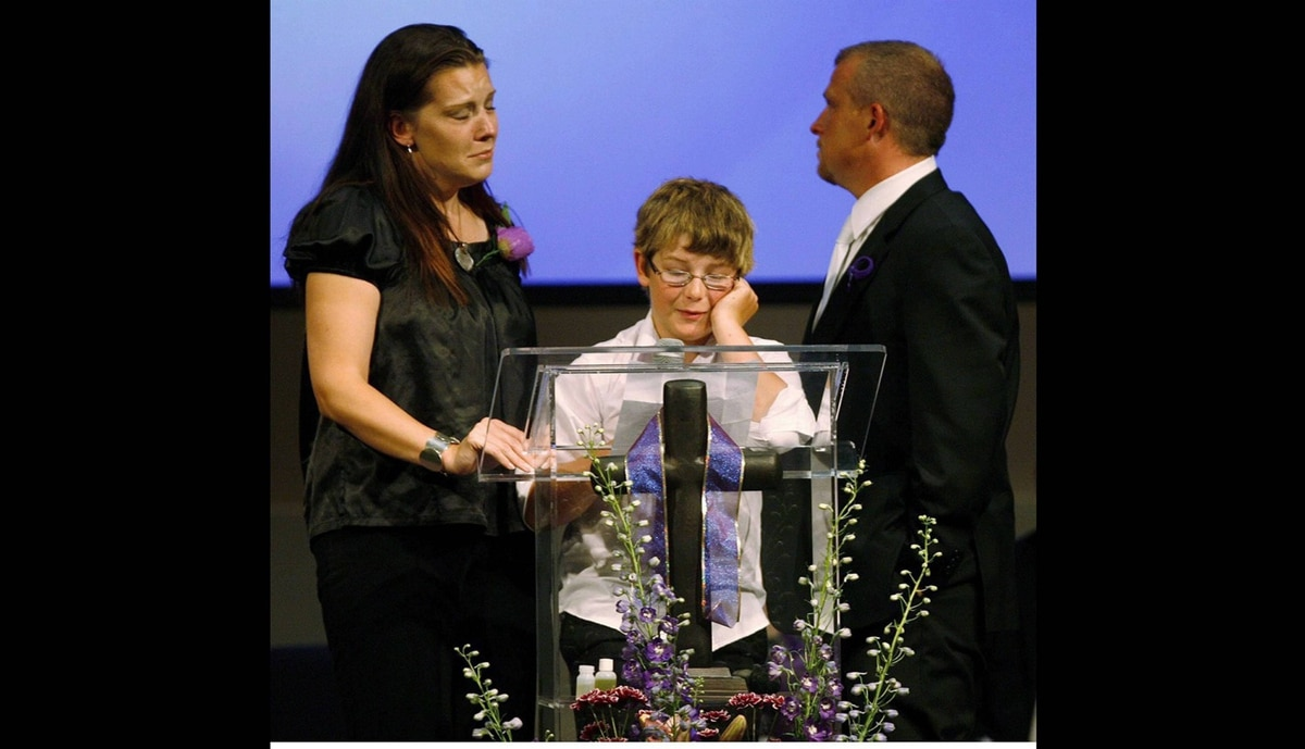 Victoria Stafford's mother Tara McDonald and father Rodney Stafford stand by her 11-year-old brother Daryn Stafford as he speaks about his sister at a memorial sevice for the murdered eight-year-old in Woodstock, Ontario, Saturday, June 6, 2009.