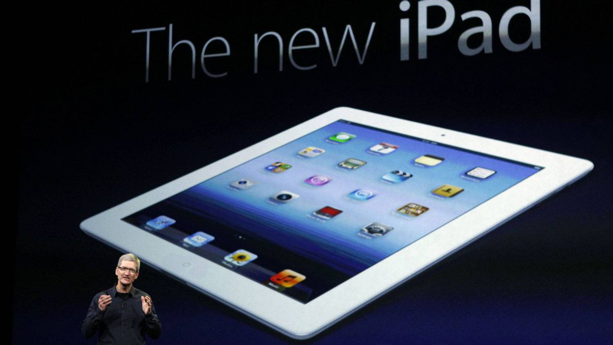 Apple CEO Tim Cook speaks during an Apple event as he introduces the new iPad as an image of the device is projected on screen in San Francisco, March 7, 2012.