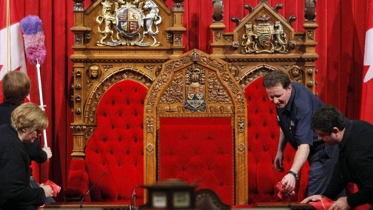 Workers clean the Senate chamber on on Feb. 25, 2010.