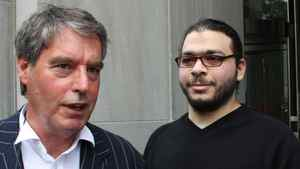 Abdullah Khadr (right) looks on as his lawyer Dennis Edney talks to media outside court in Toronto, Wednesday, Aug.4, 2010.
