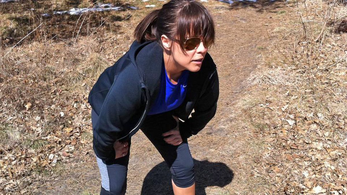 Amberly McAteer takes a break from her 5K run in Toronto's High Park, March 27, 2011