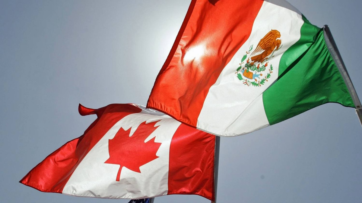 The flags of the United States, Canada and Mexico fly in the breeze at the Louis Armstrong International Airport in New Orleans ahead of a leaders summit on April 21, 2008.
