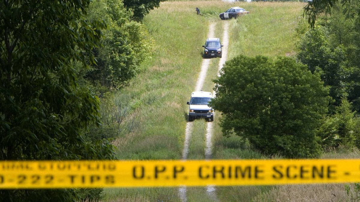 Police tape blocks the entrance to a laneway in a field about three kilometers south-east of Mount Forest, Ontario where on July 20, 2009, the OPP discovered human remains. Today the jurors in the Michael Rafferty murder trial will make the 2 1/2-hour trip from London toward the small town of Mount Forest, to see the place where Tori Stafford's body was discovered.