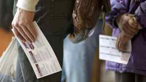 Voters wait to cast their ballots at an advance polling station in Vancouver on April 22, 2010.
