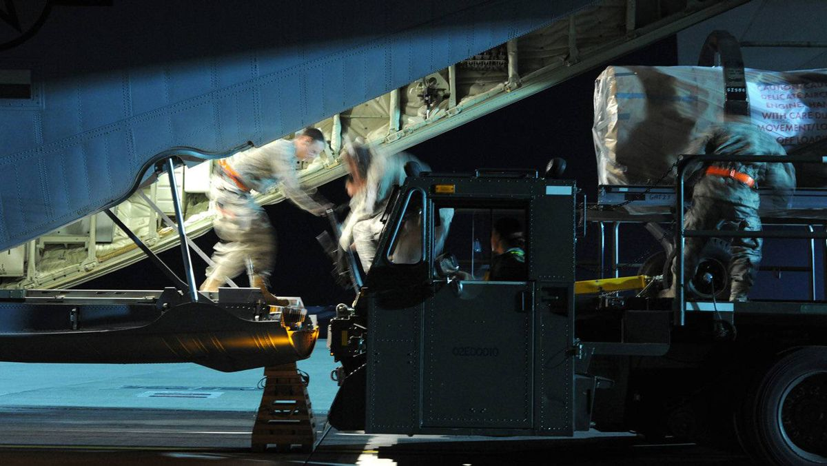 Airmen load pallets of cargo into a C-130J Super Hercules in support of Joint Task Force Odyssey Dawn at Spangdahlem Air Base, Germany, in this photo taken March 20, 2011.