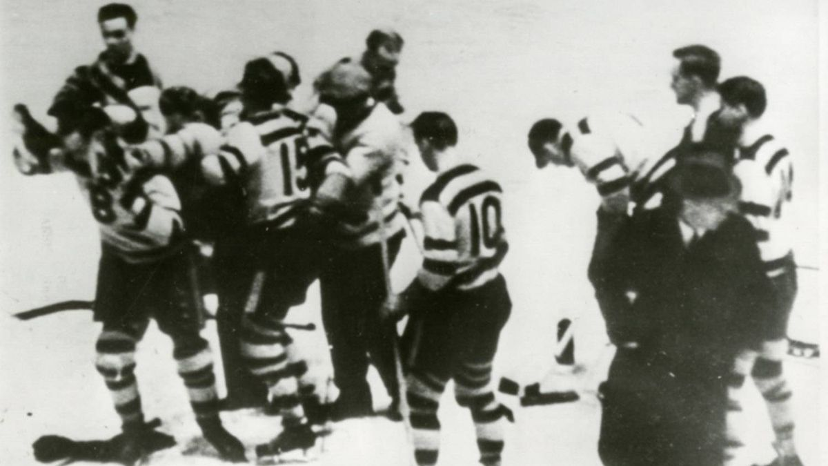 "Eddie Shore, Boston Bruins defense star, is shown being carried from the ice at the Boston Garden, Dec. 12, 1933, after he had been knocked down by Red Horner of Toronto. Horner struck Shore after the latter had ""checked"" ce Bailey, Toronto winger and sent him to the ice badly hurt. Bailey suffered a fractured skull."