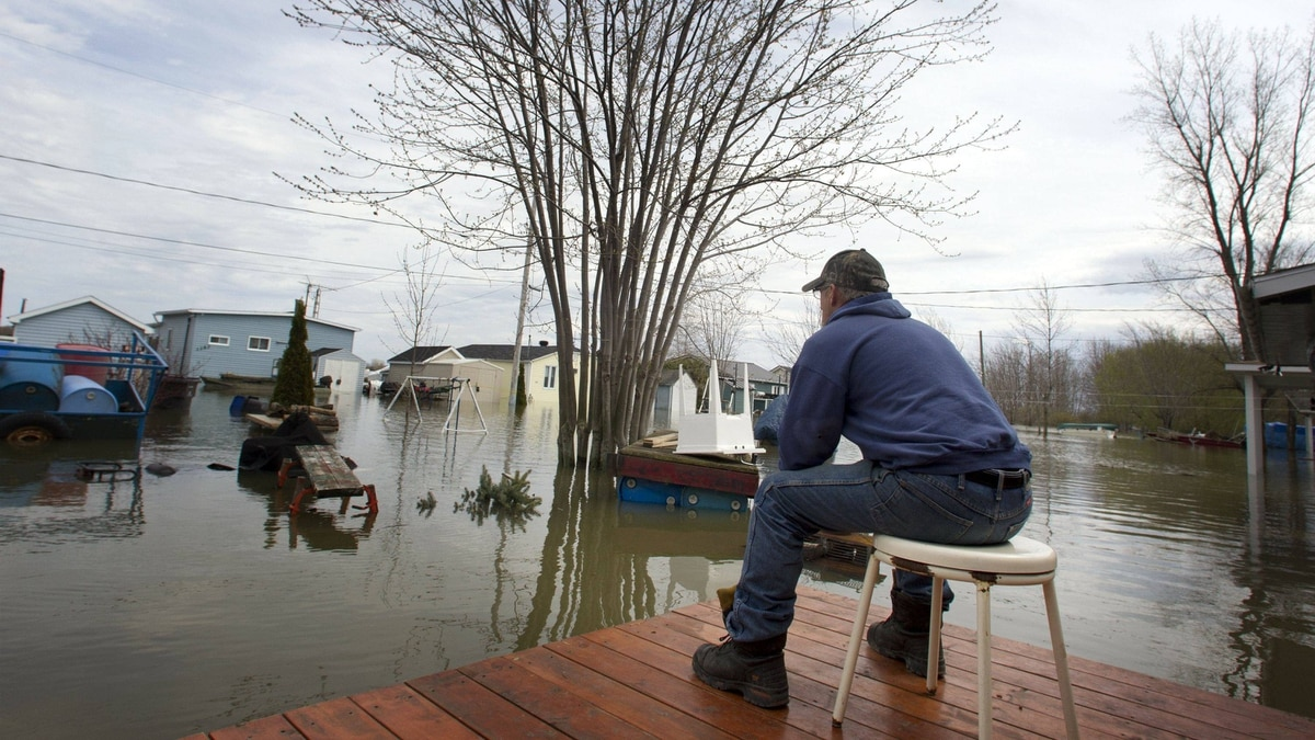 Gerald Racine, the lone resident staying in his his flooded neighbourhood looks out his street in St-Paul-de-I'Ile-aux-Noix, May 6, 2011.