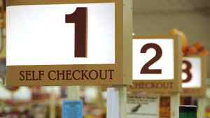 In this Sept. 23, 2011 photo, a row of self checkout lines are available at a Big Y supermarket in Manchester, Conn. A growing number of supermarket chains are bagging their self-serve checkout lanes, saying they can offer better customer service when clerks help shoppers directly. Big Y Foods, which has more than 60 southern New England locations, recently became the latest to announce it's phasing them out.
