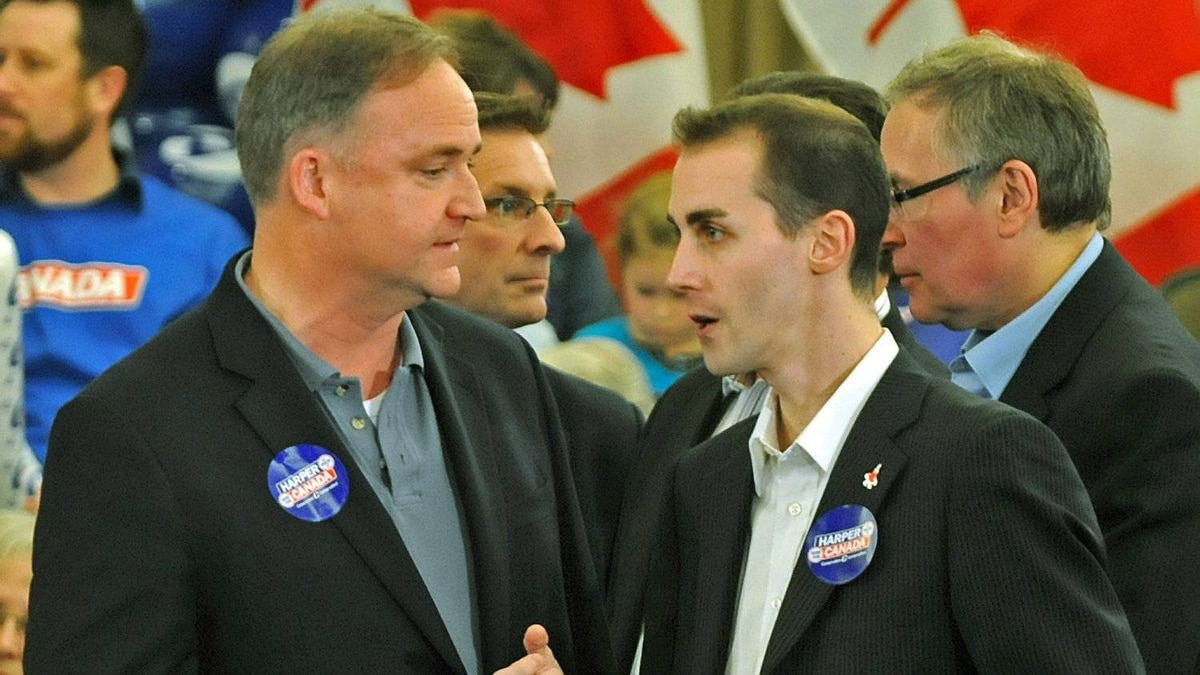 Guelph Conservative MP Marty Burke, left, chats with his director of communications Michael Sona before the Here for Canada rally April 4, 2011 in Guelph, Ontario.