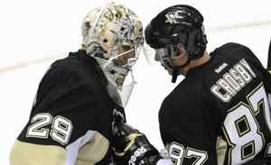 Pittsburgh Penguins' Sidney Crosby and Marc-Andre Fleury congratulate each other after the Penguins defeated the New York Islanders in an NHL hockey game in Pittsburgh, Pennsylvania November 21, 2011.