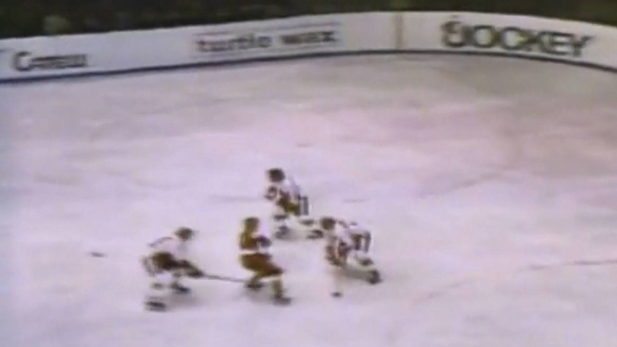 This YouTube image shows Bobby Clarke breaking Valery Kharlamov's ankle during the 1972 Team Canada vs. USSR Summit Series game.