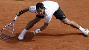Italy's Fabio Fognini slips on the clay as he plays as he plays Spain's Albert Montanes during their fourth round match. Fognini won 4-6, 6-4, 3-6, 6-3, 11-9. (AP Photo/Lionel Cironneau)