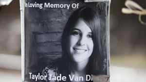 A memorial of photographs, flowers, stuffed animals and candles have been displayed recently at the railway crossing in Armstrong, B.C., where the body of Taylor Van Diest was discovered.