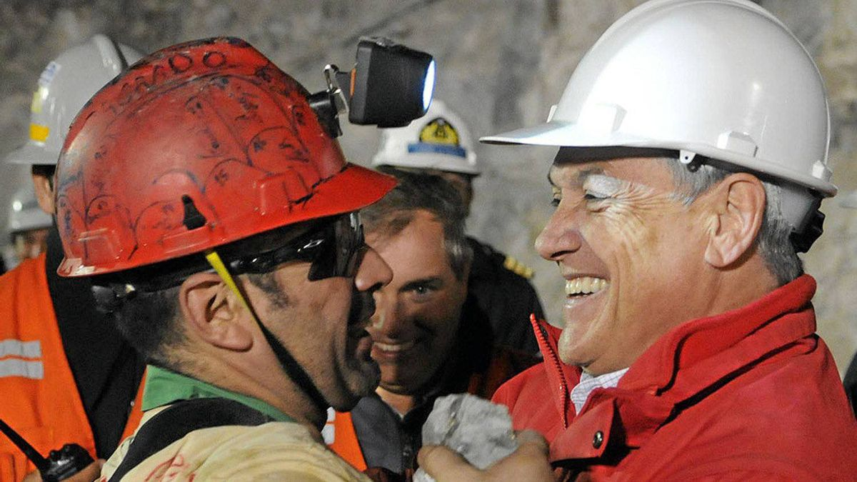 Chilean President Sebastian Pinera, right, hugs Mario Sepulveda after the miner was rescued from the collapsed San Jose gold and copper mine where he was trapped with 32 other miners for more than two months.