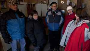 Grand Chief Stan Loutit, Band Chief Theresa Spence, MP Charlie Angus and NDP Interim leader Nycole Turmel listen to a resident of Attawapiskat. November 29, 2011.