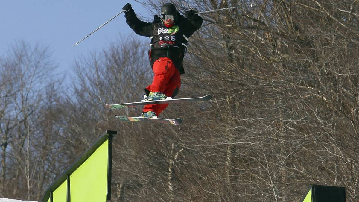 Mike Mertion of Vernon, B.C. jumps off a rail during slopestyle training for the Winter Dew Tour in Killington, Vermont, Thursday, Jan. 19, 2012.