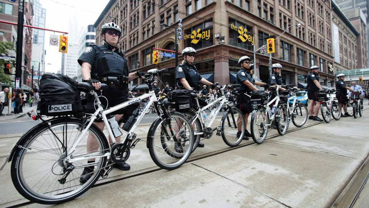 A column of police officers lines a street in Toronto ahead of the G20 summit.