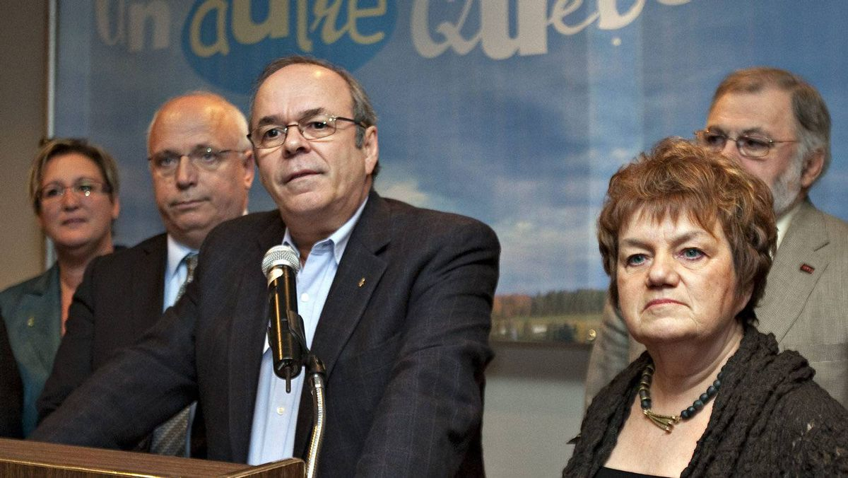 Union Leaders Michel Arsenault, FTQ, flanked by Rejean Parent, left, CSQ, and Claudette Carbonneau, CSN, stand with other union leaders in a coalition called Alliance Sociale Friday, November 5, 2010 in Quebec City. The alliance claims to be a response to the Reseau Liberte Quebec.