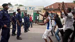 Supporters of the opposition Union for Democracy and Social Progress (UDPS) face police in Kinshasa on December 23, 2011.