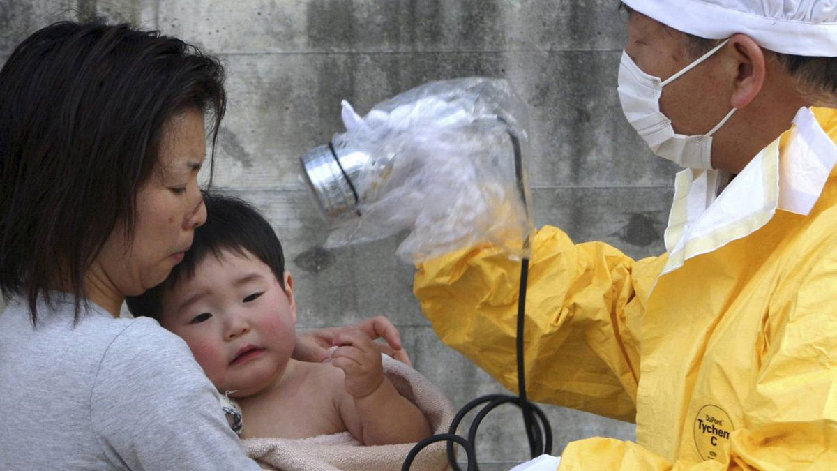 A one-year-old boy is re-checked for radiation exposure after being decontaminated in Nihonmatsu, Fukushiima, northern Japan Monday, March 14, 2011.