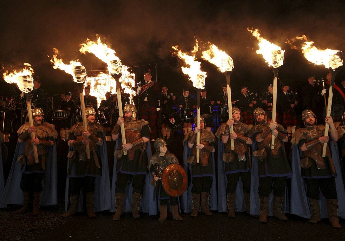 Up Helly Aa vikings from Lerwick in the Shetland Islands participate in the annual torchlight procession to mark the start of Hogmanay (New Year) celebrations in Edinburgh, Scotland.