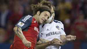 Toronto FC's Torsten Frings battles for the ball with LA Galaxy's Mike Magee (R) during the first half of their CONCACAF Champions League quarter finals soccer match in Toronto, March 7, 2012.