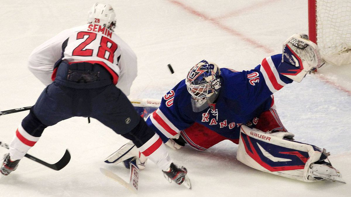 New York Rangers goalie Henrik Lundqvist (R) makes a save on Washington Capitals' Alexander Semin during the second period in Game 7 of their NHL Eastern Conference semi-final playoff hockey game at Madison Square Garden in New York May 12, 2012. REUTERS/Shannon Stapleton