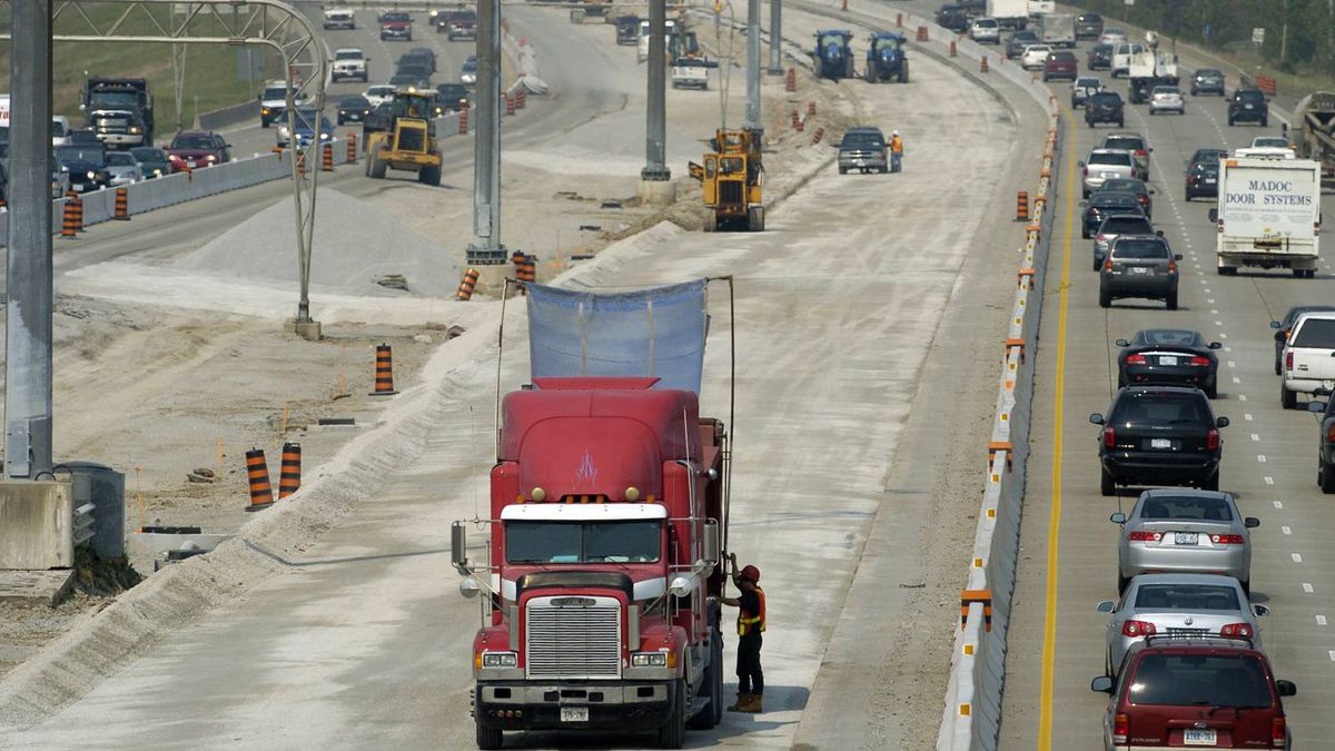 Aecon road crews work on Highway 407, north of Toronto.