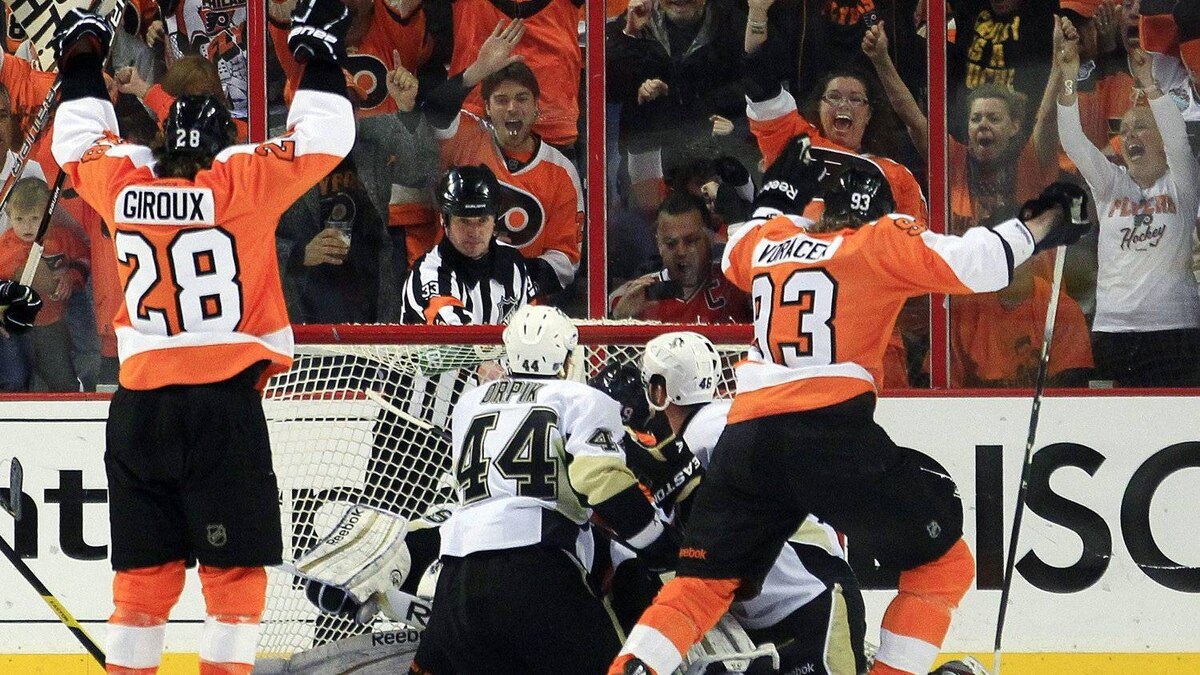 Philadelphia Flyers' Claude Giroux, left, and Jakub Voracek, right, celebrate a goal by Scott Hartnell against the Pittsburgh Penguins during the first period in Game 6 of an NHL hockey Stanley Cup first-round playoff series, Sunday, April 22, 2012, in Philadelphia.