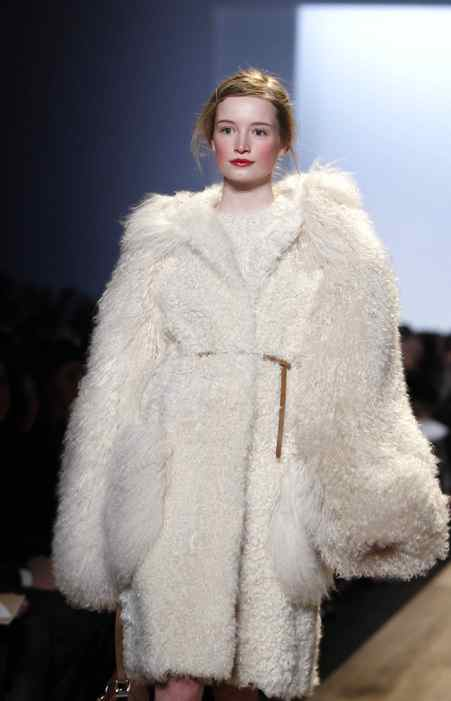 Kors sent out a tight vision for fall: Oversized luxurious furs mixed with graphic checks and plaids. Many of the coats, like this one in ivory alpaca, were extra shaggy. Purely by coincidence, the Westminster Dog Show also took place this week in New York.