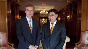 Ed Frackowiak, Chairman and CEO of Wescast Industries Inc. left, and Dong Ping, Chairman and CEO of Sichuan Bohong Industry Co., right, pose for a photo in Toronto, Ont. Monday, September 12, 2011.