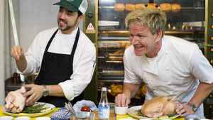 Chef Gordon Ramsay, right, speaks to reporters during a cooking demonstration at his new restaurant 'Laurier Gordon Ramsay', in Montreal, Tuesday, August 9, 2011 as head chef Guillermo Russo looks on.