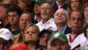 (L-R) Former attorney general of Arizona Grant Woods and U.S. Senator John McCain attend the NHL game between the Chicago Blackhawks and the Phoenix Coyotes at Jobing.com Arena on March 20, 2011 in Glendale, Arizona. The Blackhawks defeated the Coyotes 2-1.