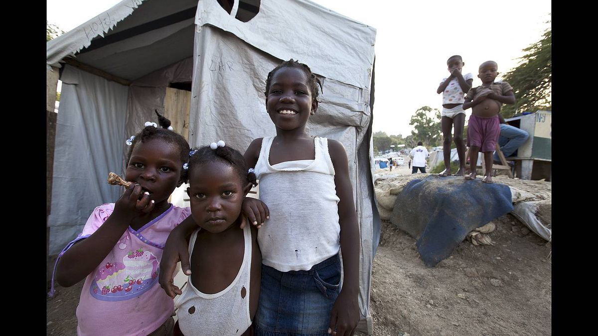 Children pose for a picture at the Pentionvile Golf Course Camp for Displaced Persons in Port-au-Prince, Haiti.