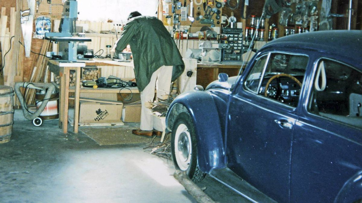 Peter Cheney's father, Major Ben Cheney, in his Vancouver Island garage with Peter's last Beetle, a 1967 model