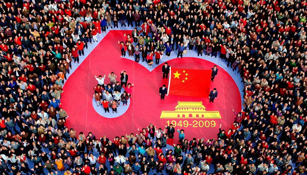 People gather at a square to celebrate the upcoming 60th anniversary of the founding of the People's Republic of China during a photo call in Jilin, Jilin province on Sept. 29, 2009.
