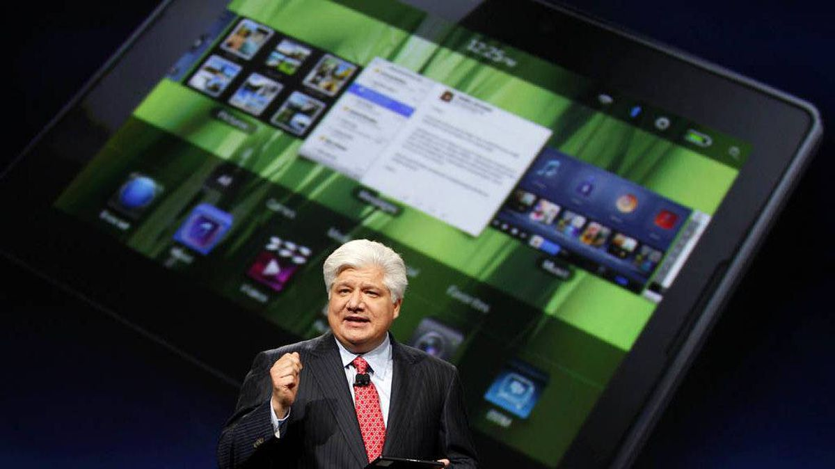 Mike Lazaridis, president and co-chief executive officer of Research In Motion, holds the new Blackberry PlayBook with a screen projection of the device as he speaks at the RIM Blackberry developers conference in San Francisco, California in this September 27, 2010 file photo.