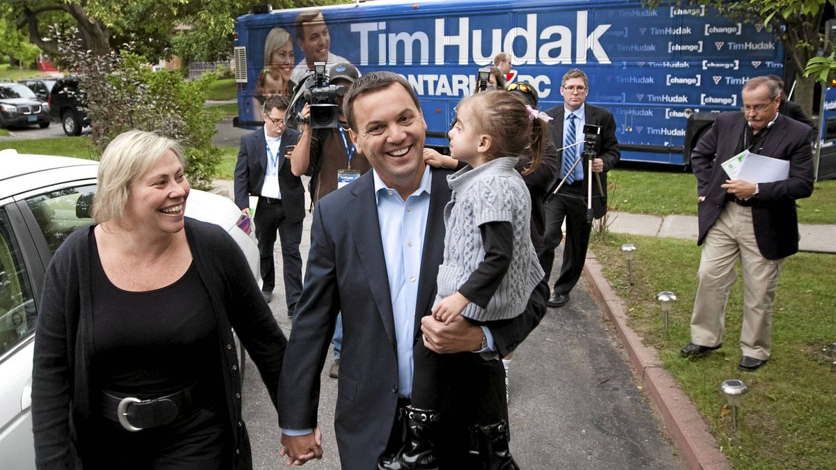 Ontario PC Leader Tim Hudak, centre, arrives for a photo-op with wife Deb Hutton, left, and their three-year-old daughter Miller in Scarborough, Ont., on Sept. 6, 2011.